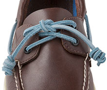 Watch how to tie a tassel lace knot.