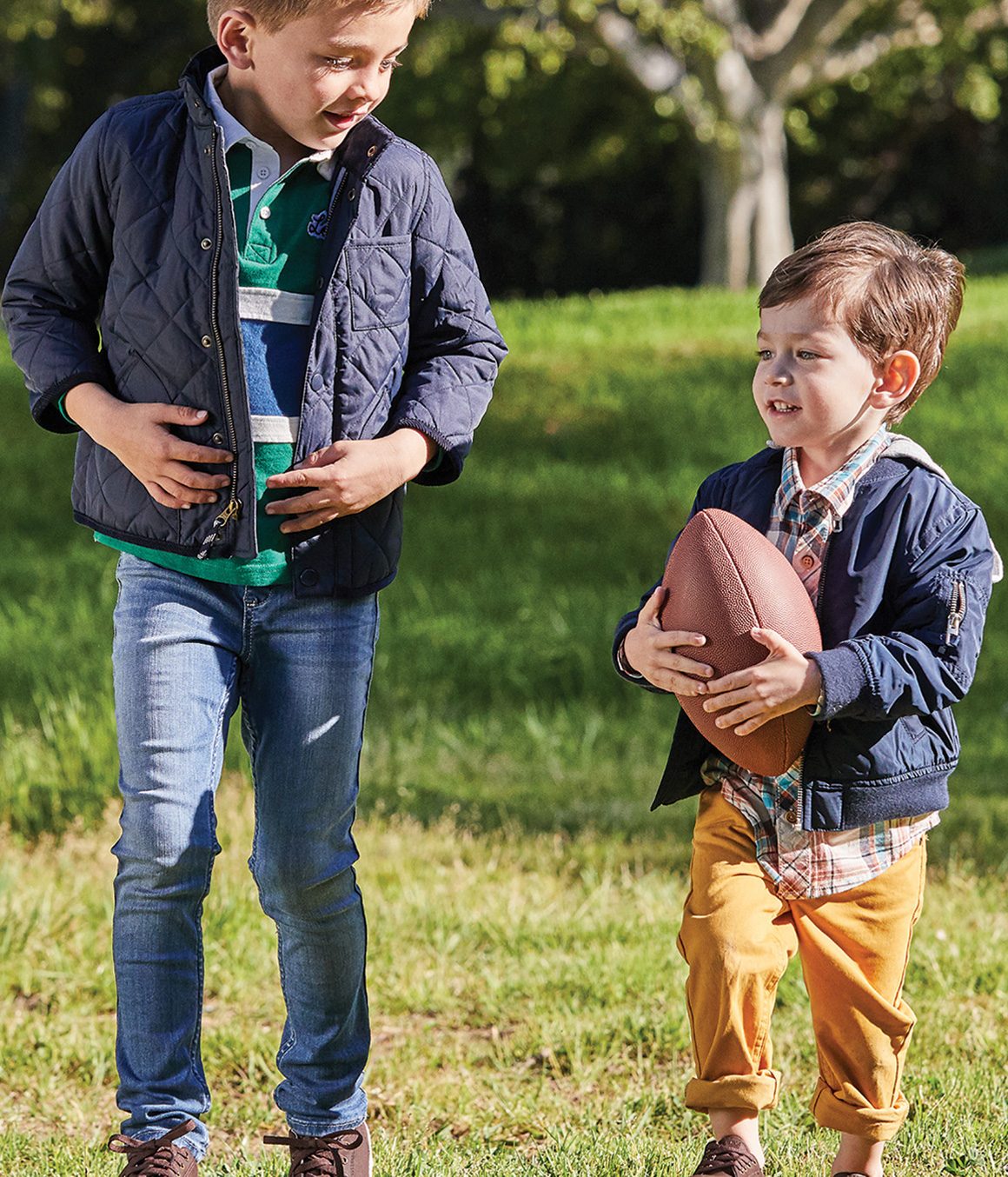 Two kids playing a ball.
