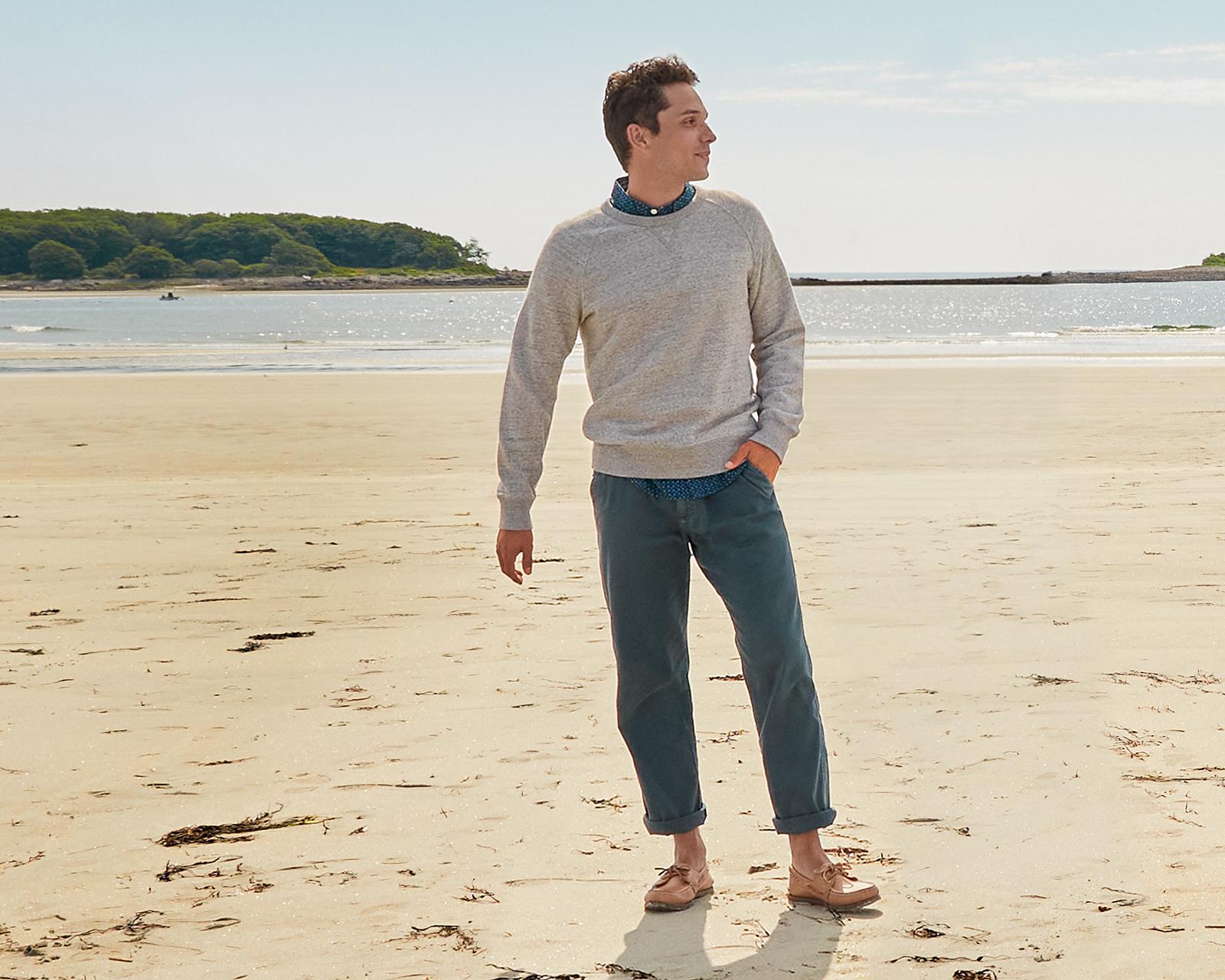 Man standing in front of the ocean.
