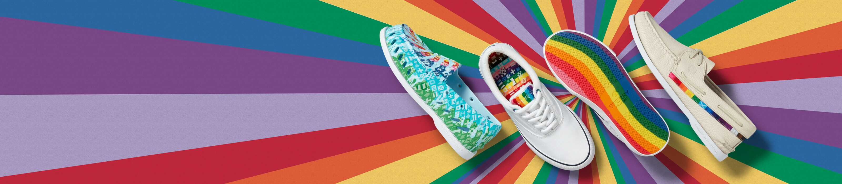 Rainbow-accented shoes on a rainbow background.