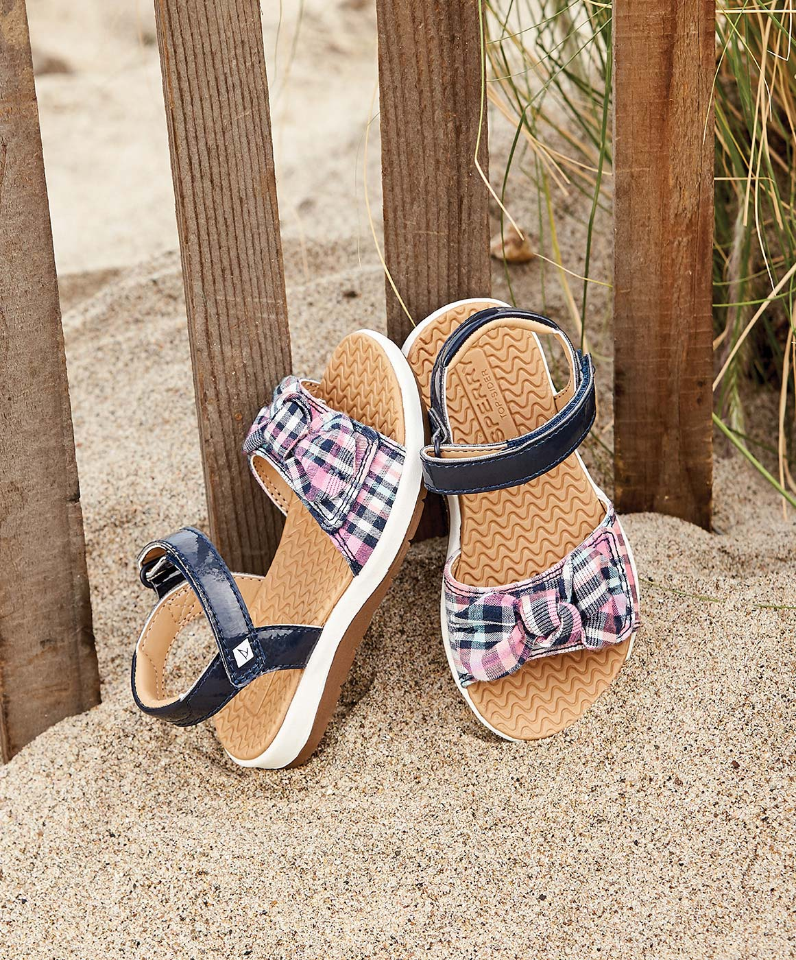 Kids sandals on the beach.