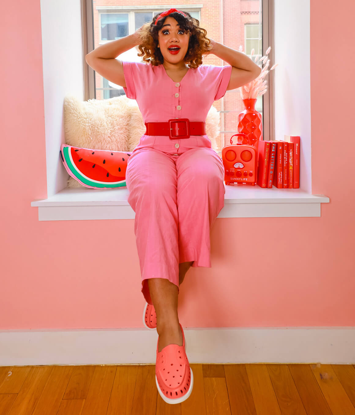 Courtney dressed all in pink with pink Floats.
