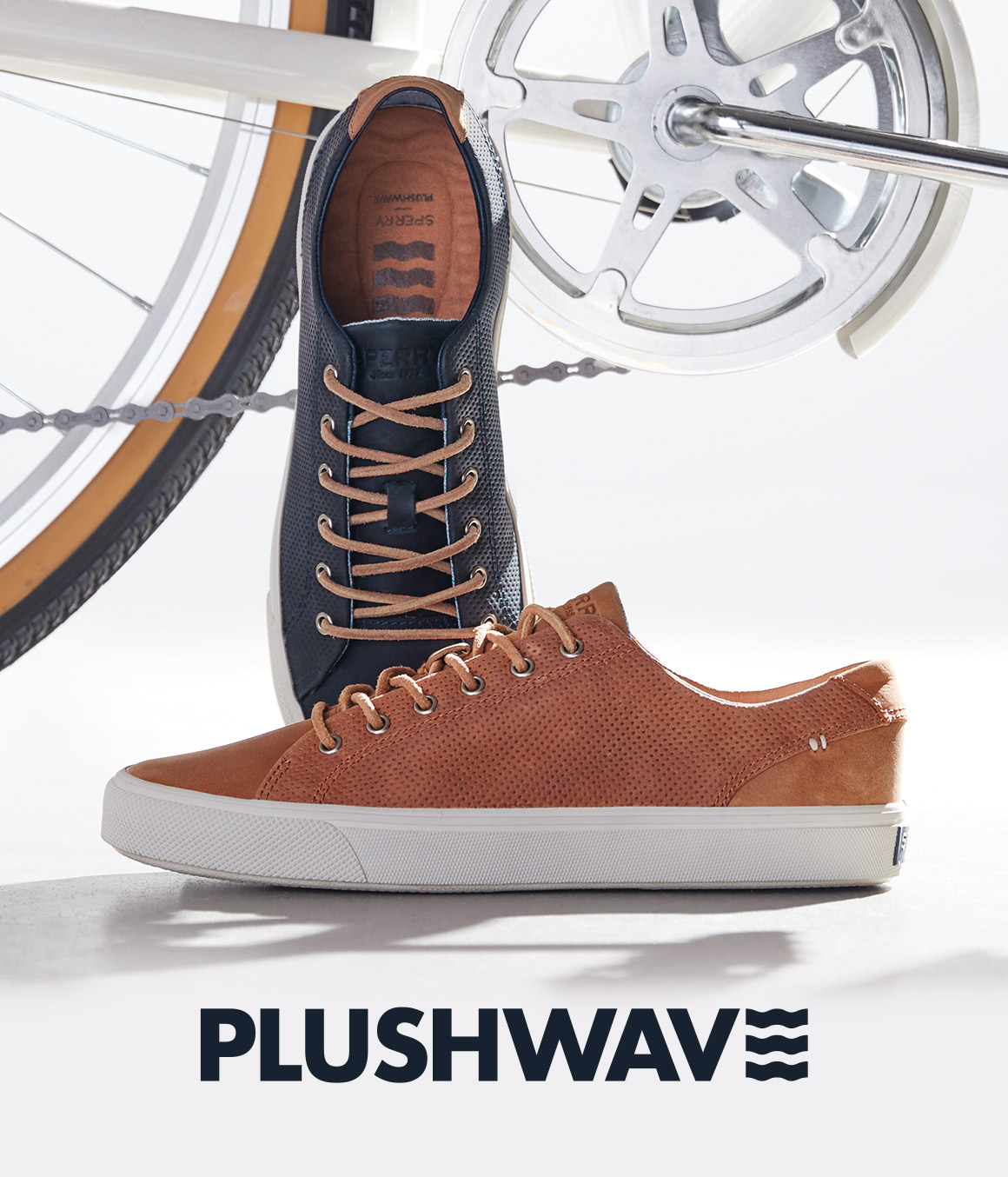 Two mens Plushwave shoes beside the bike.
