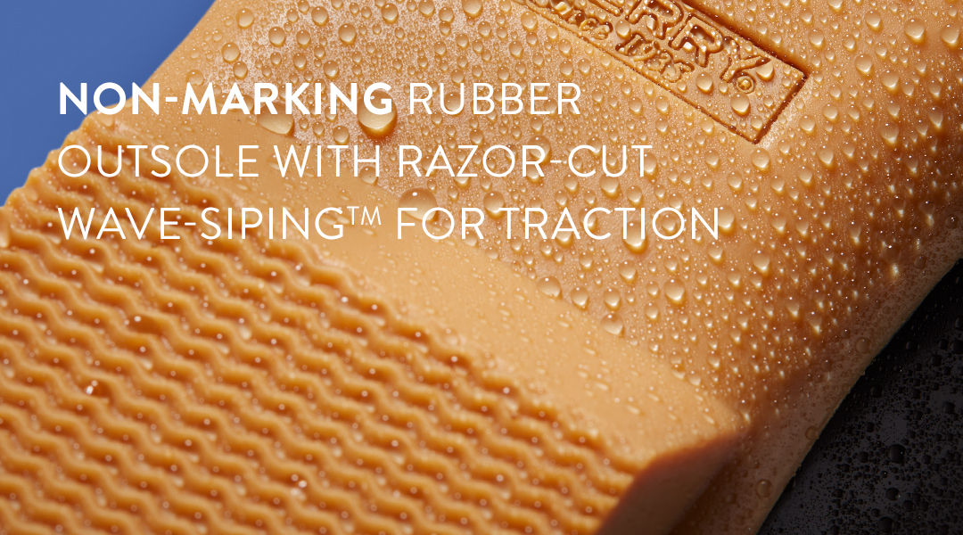 Non-marking rubber outsole with razor-cut wave-siping for traction.