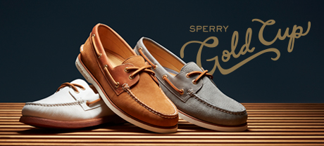3 mens Sperry Gold Cup shoes lined up on a wood floor.