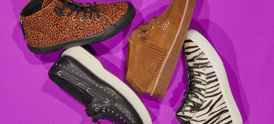 Rebecca Minkoff collab shoes on a purple background.