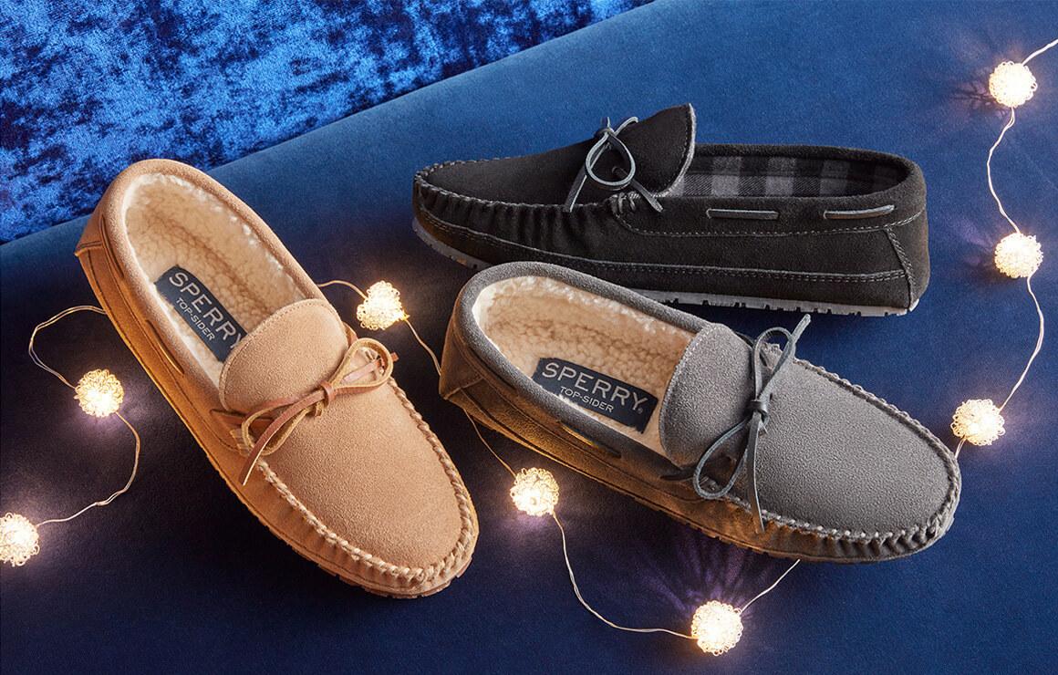 slippers amid tree lights.
