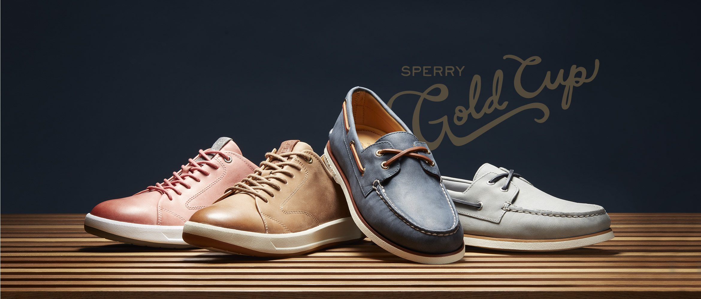 f89919a5866d SPERRY Gold Cup shoes on display with a blue background.