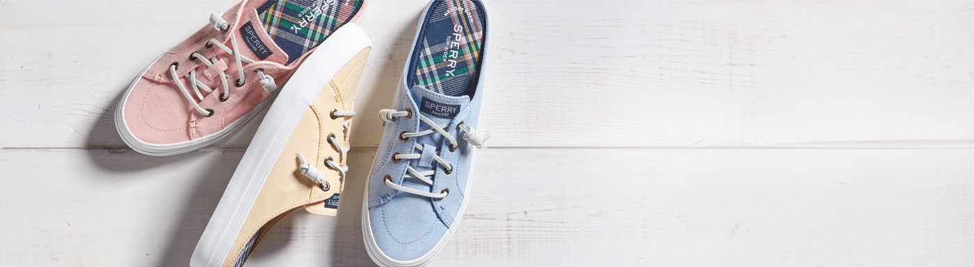 Three Pastel Mule Sperry shoes.