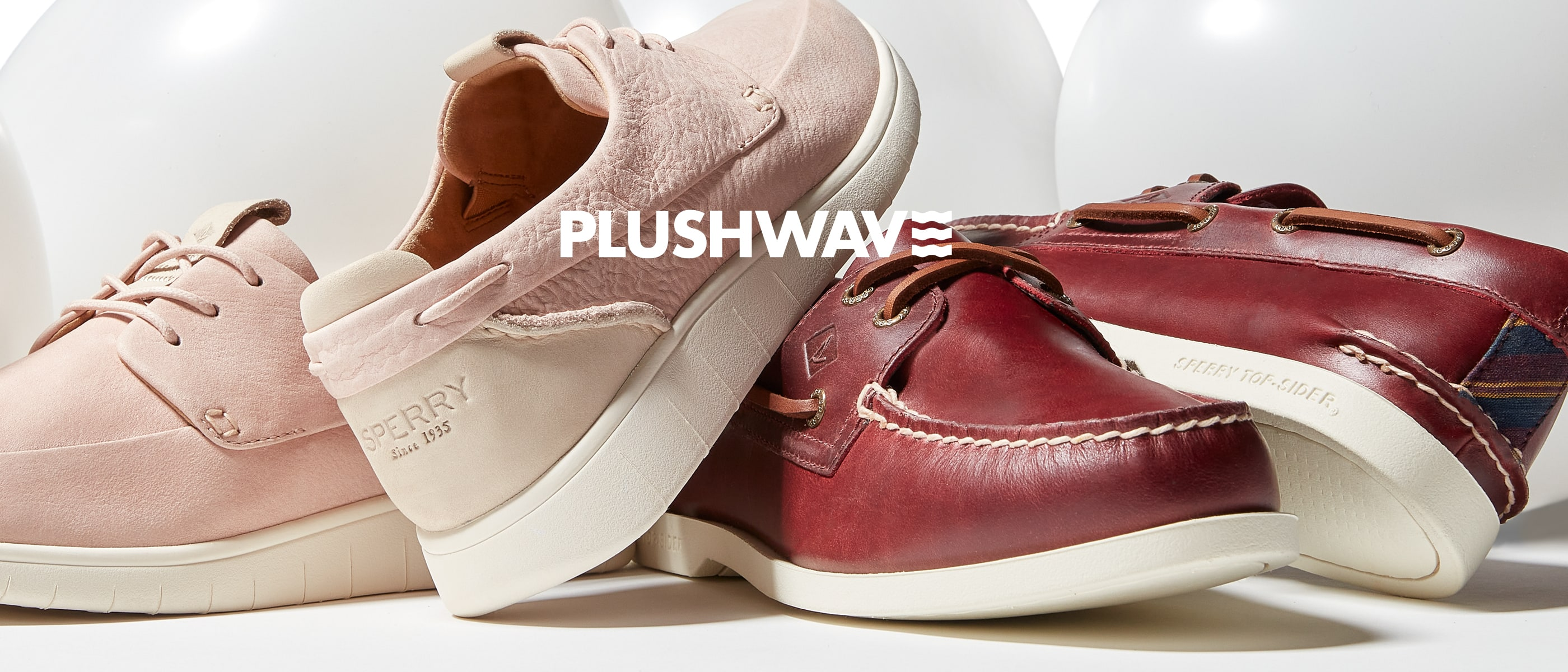 Mens and womens Sperry Plushwave shoe pairs.