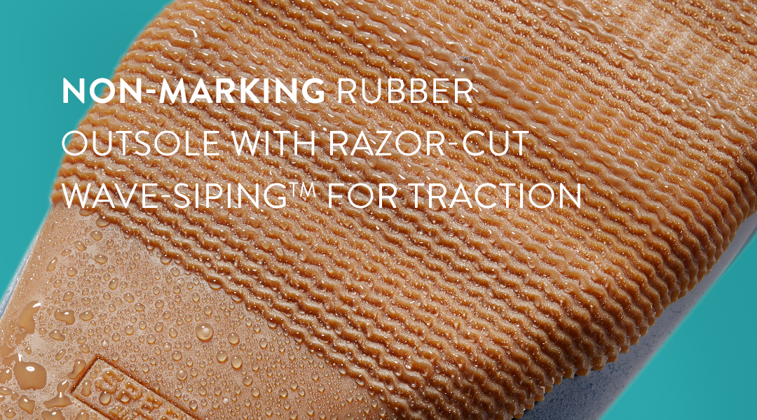 Non-marking rubber outsole with razor-cut wave-siping for traction