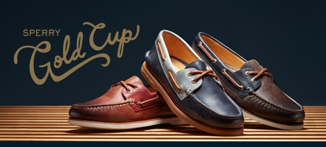 3 mens Sperry Gold Cup shoes lined up on a wood floor