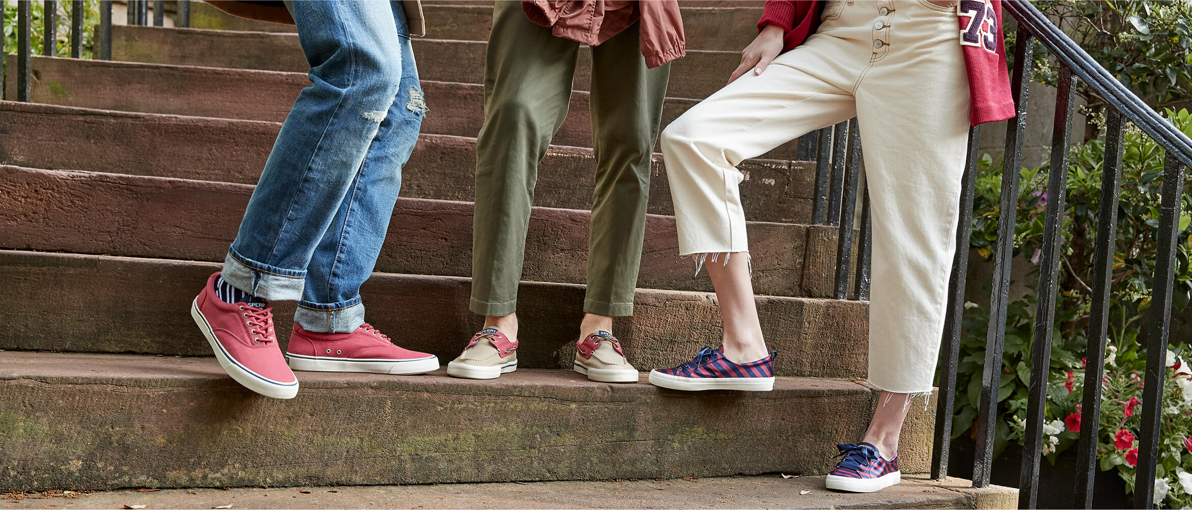 Three people stand on stone steps. We see them from the knees down and can't take our eyes off their shoes; they are totes fancy!