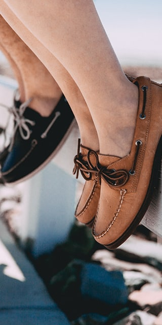 2 People wearing Sperry boat shoes.