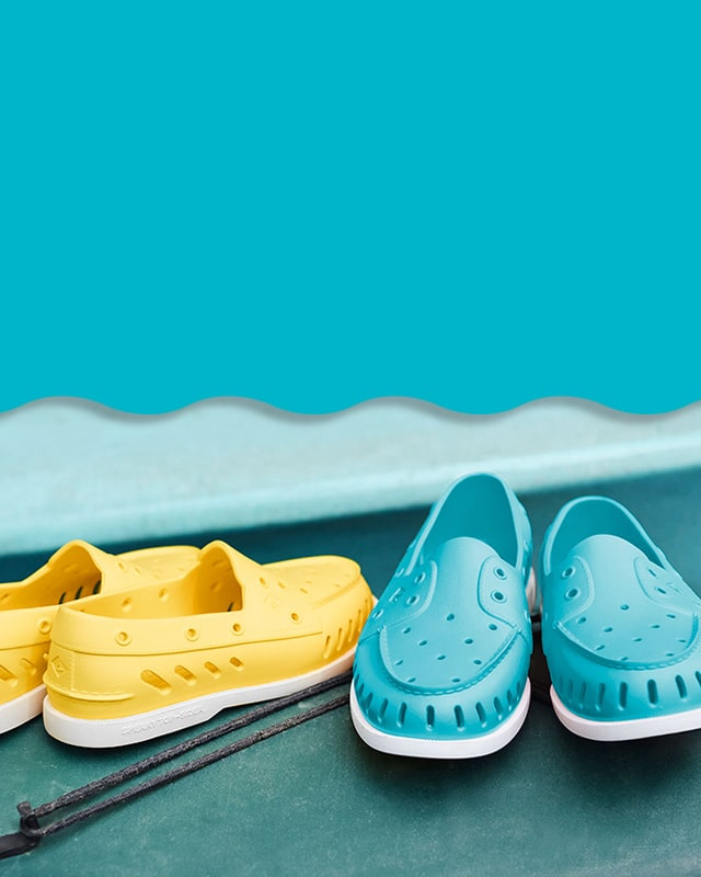 A pair of blue and yellow Sperry float shoes.