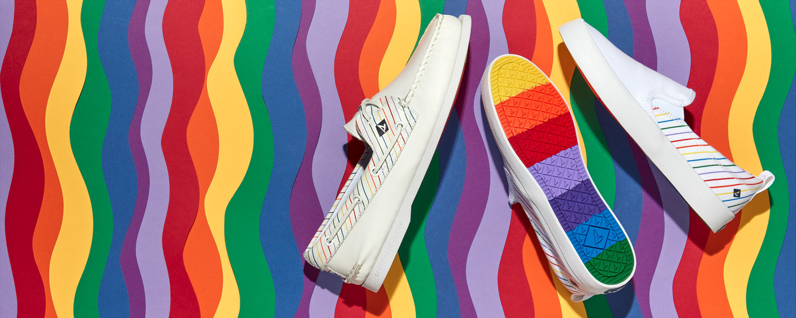 Rainbow colored pride Sperry shoes.