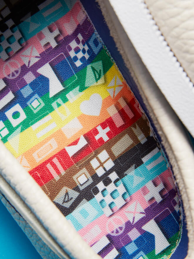 Cream leather shoe with rainbow icon insole.