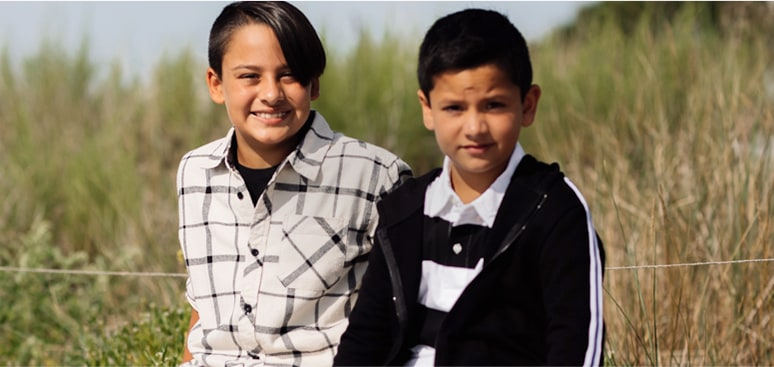 Two kids in a field.