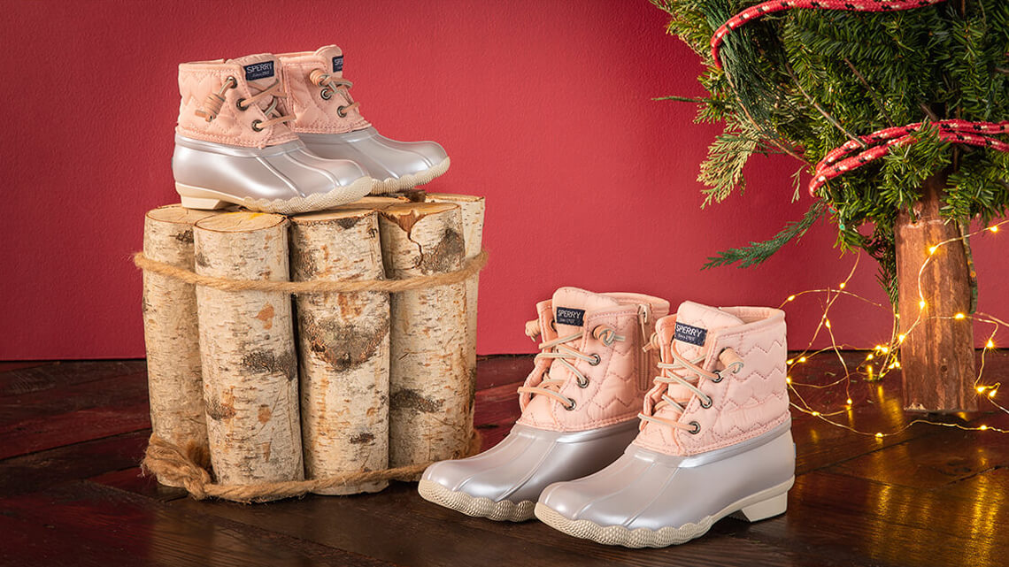 Large and small Saltwater boots in pink & silver.