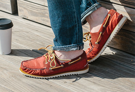Blogger Dillon Burke styles red boat shoes that pop.