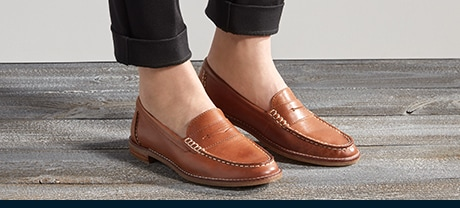 Person wearing a pair of womens Sperry Seaport shoes