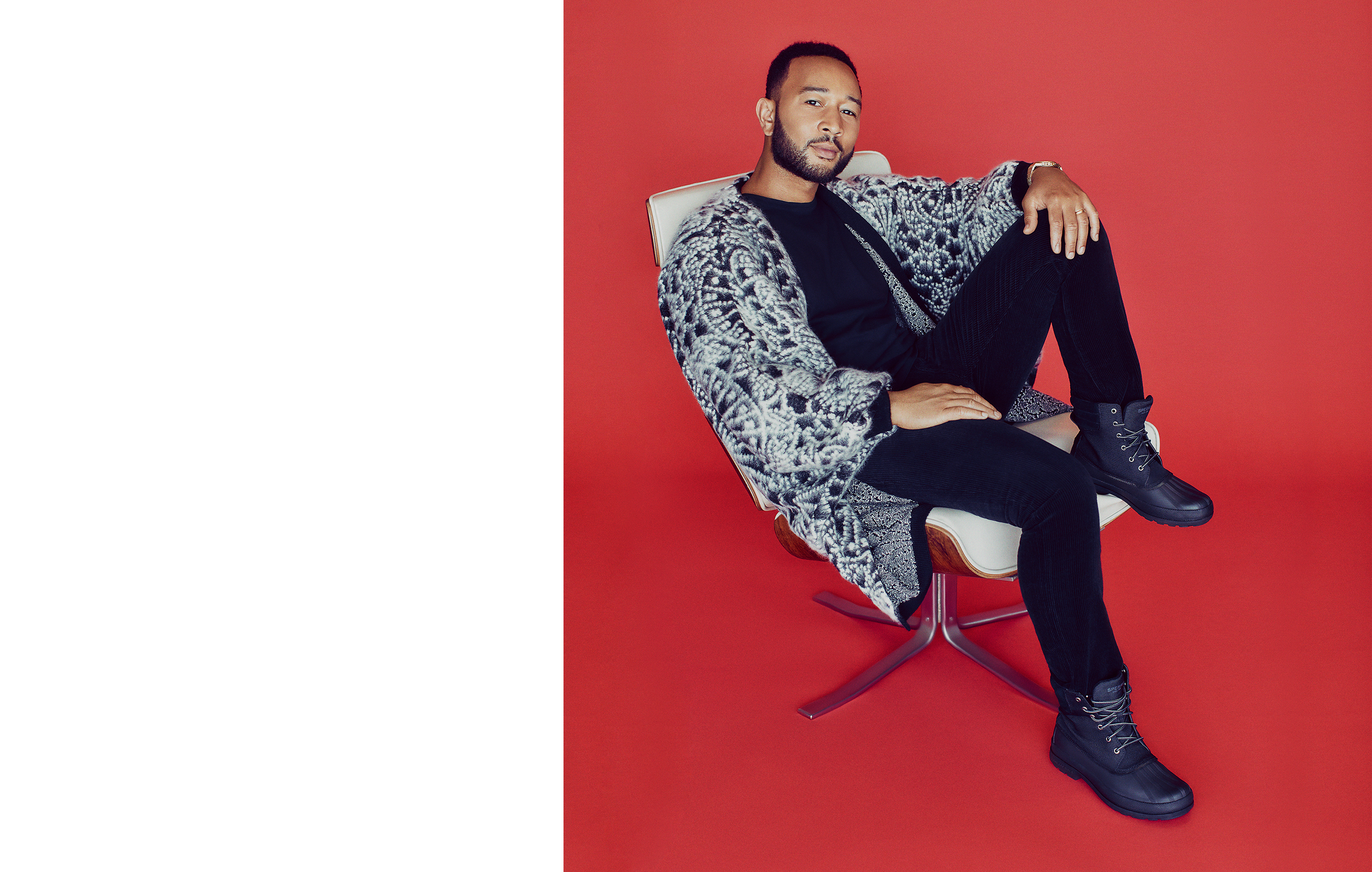 John Legend laid back in a chair just chilling with one foot on the chair wearing Sperry Cold Bay Nylond Duck Boots.