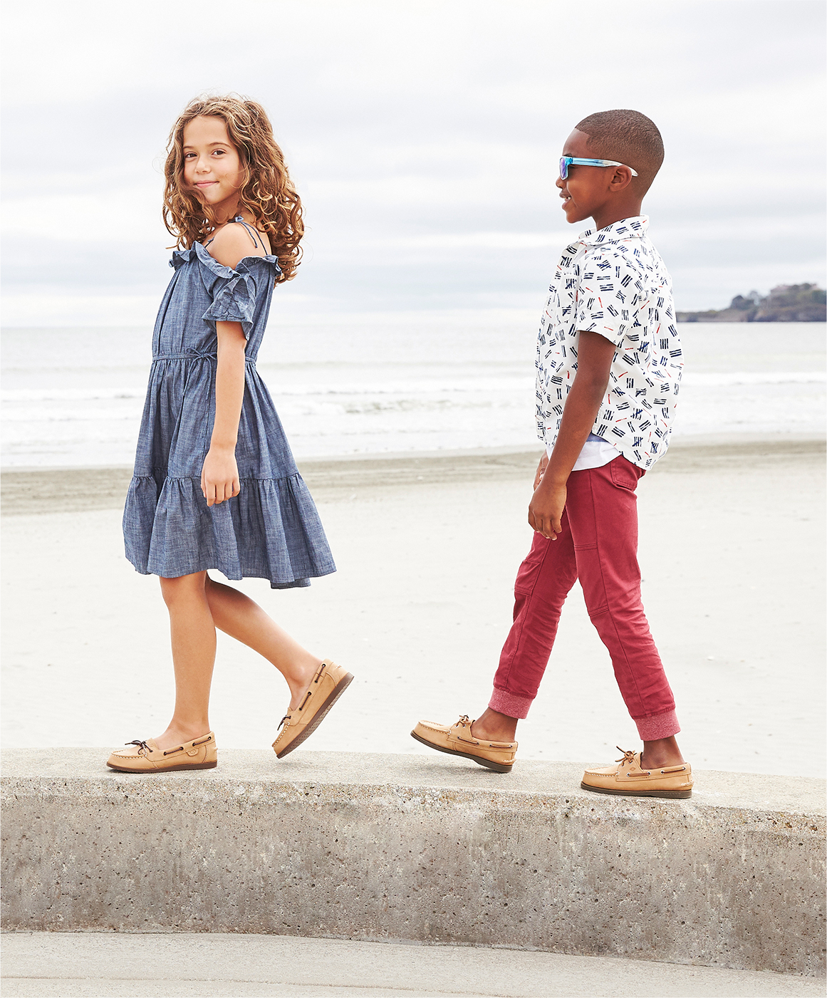 Kids walking while wearing Sperry boat shoes.