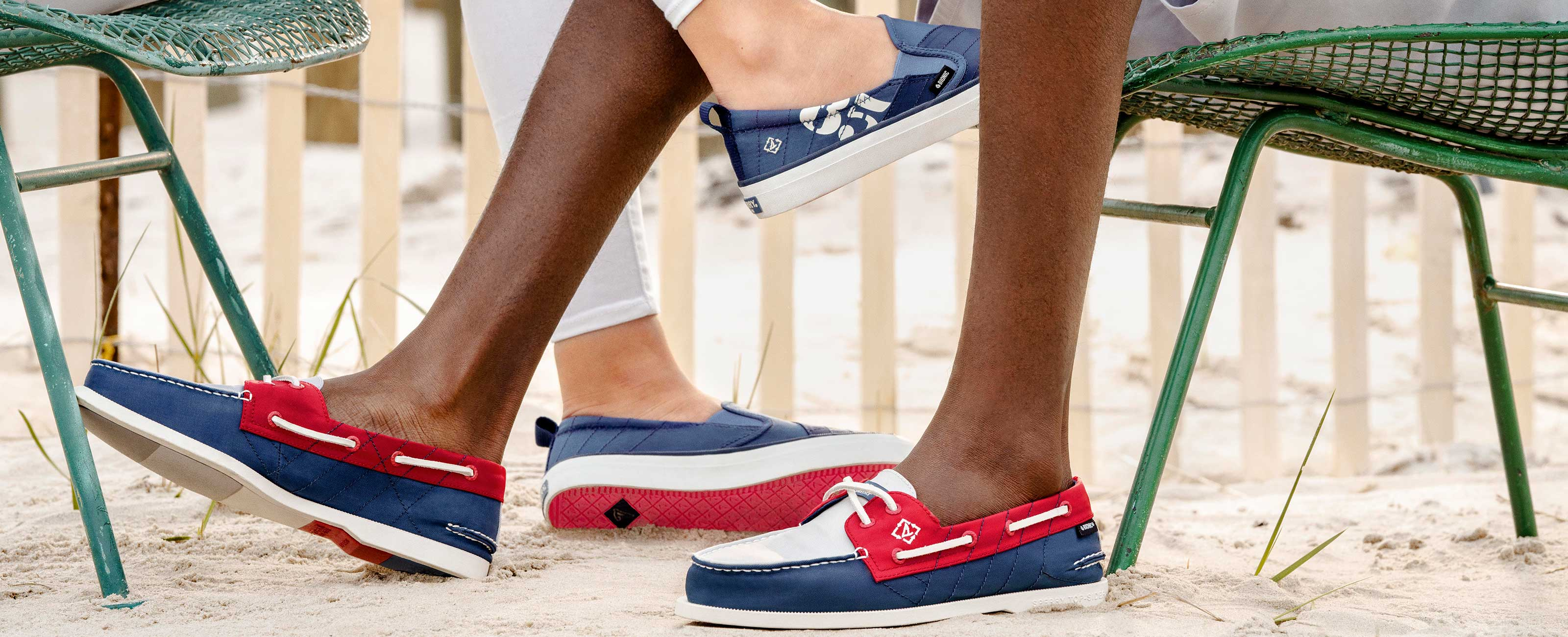 Close up of two pairs of feet wearing Bionic boat shoes.