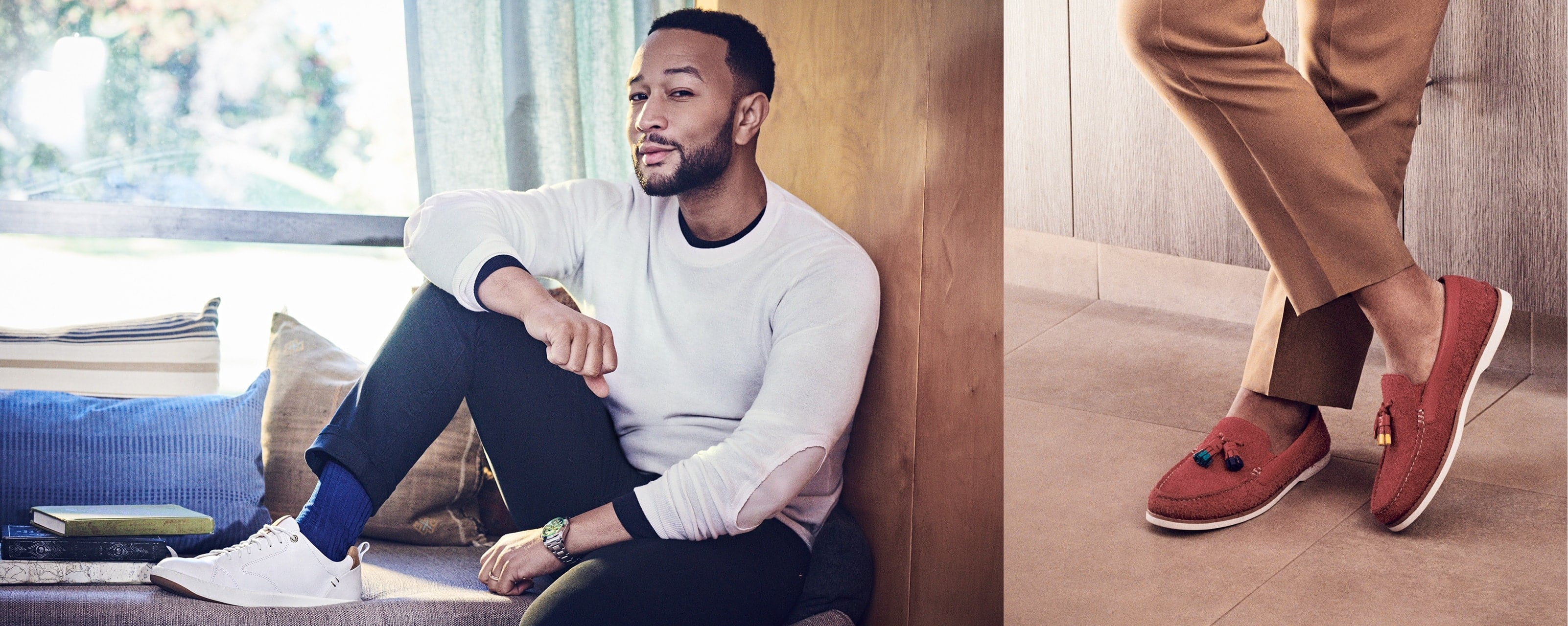 John Legend standing on a dock next a wooden rowboat, wearing Sperry Boat Shoes.