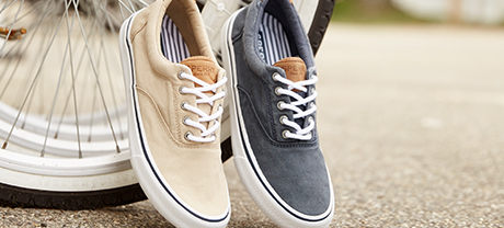 2 Sperry Striper II sneakers.