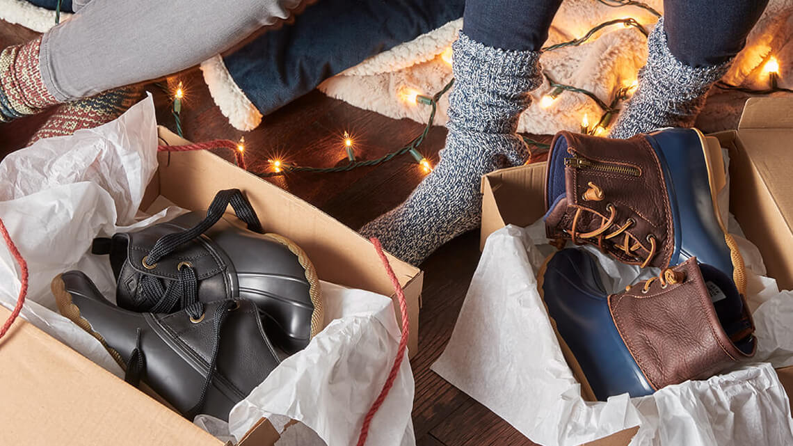 People are opening gifts; WOOT! IT'S BOOTS! They eagerly jam their toes into them and almost immediately their feet are toasty warm. Hurrah!