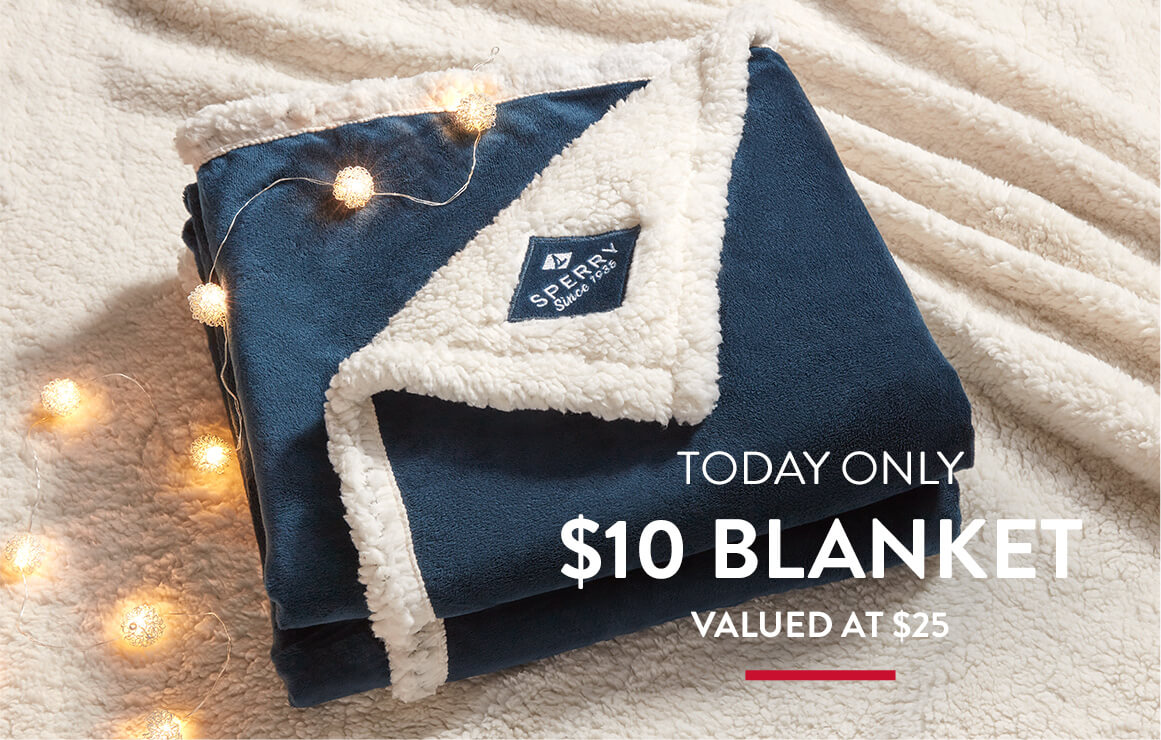 Today only. Cozy looking blue and white fleecy blanket surrounded by tree lights.