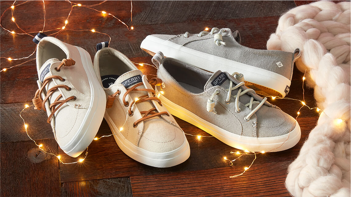 Sneakers in two colors wrapped in decorative electric lights. That can't be to code... unless you mean the DRESS CODE!