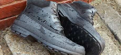 A pair of Weather-Ready Boots lying on their sides.