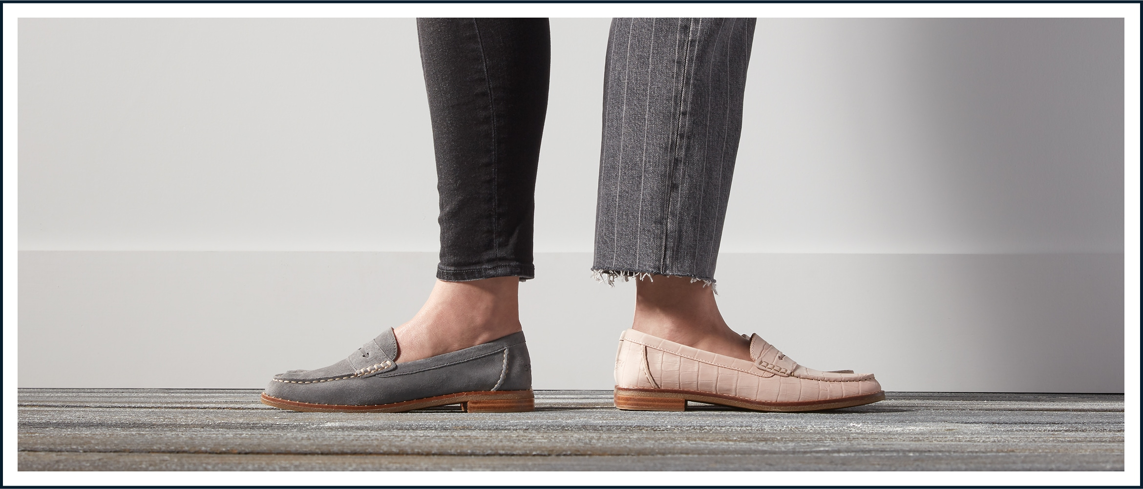 A closeup of two women's feet wearing different Seaport Penny Loafer styles.