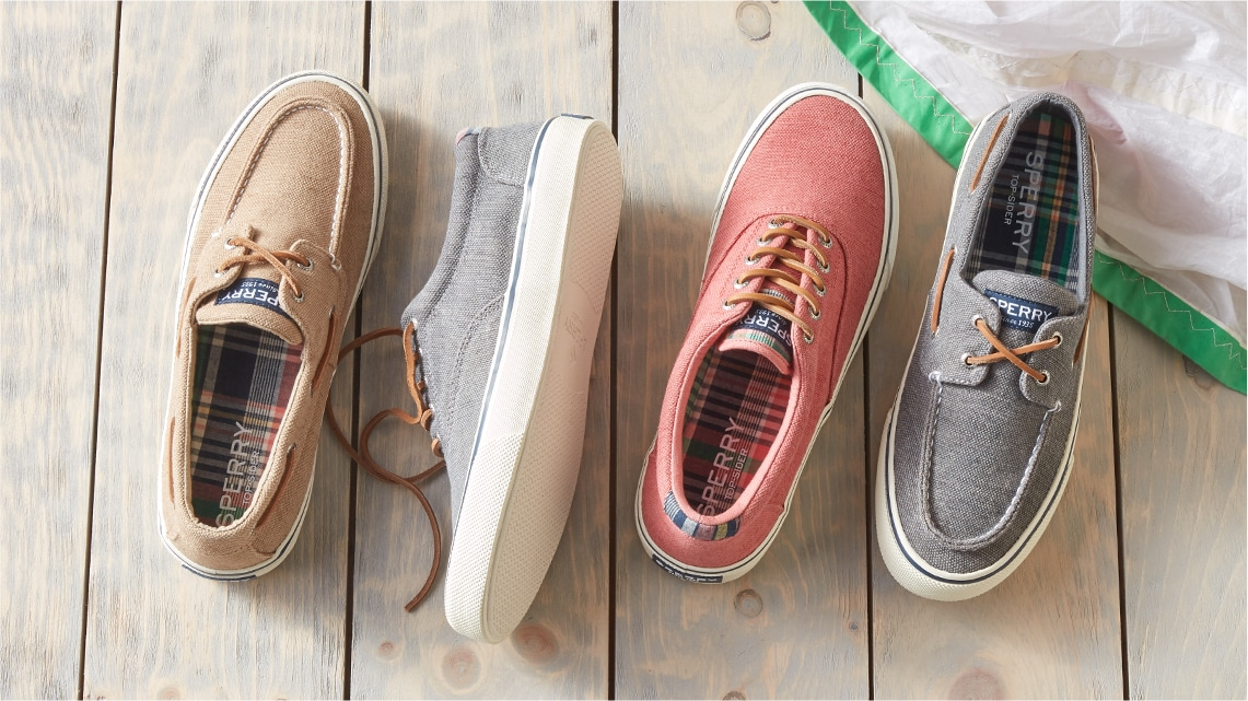 4 Sperry sneakers on a wood deck