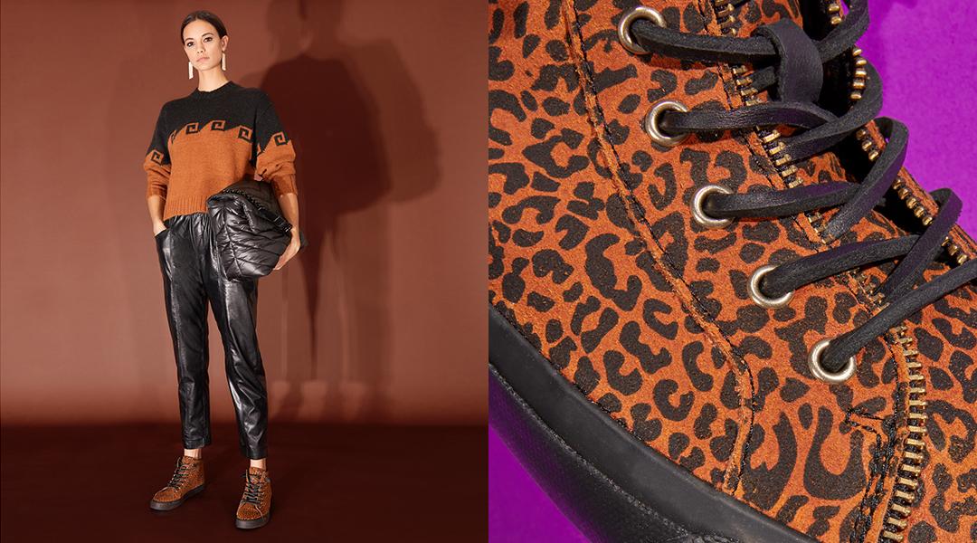 Model wearing Rebecca Minkoff Moc slider shoes.