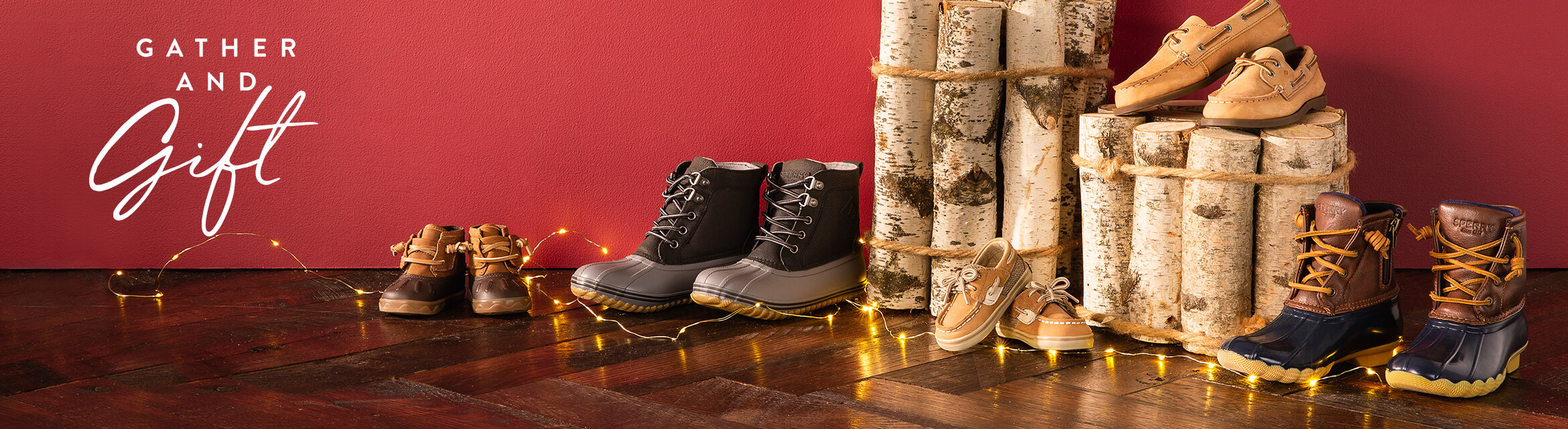 Duck boots in varying sizes are lined up against a wall, surrounded by festive decorations.