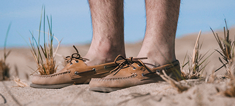 A man wearing Sperry Authentic Original shoes.