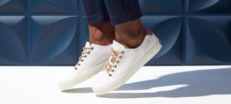 2 Sperry Striper II sneakers.