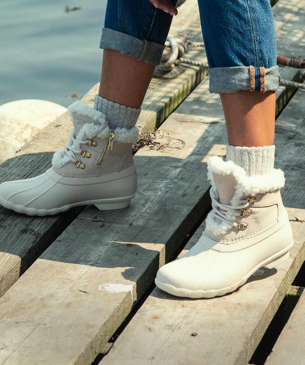 Fleece-lined boots on a boardwalk.